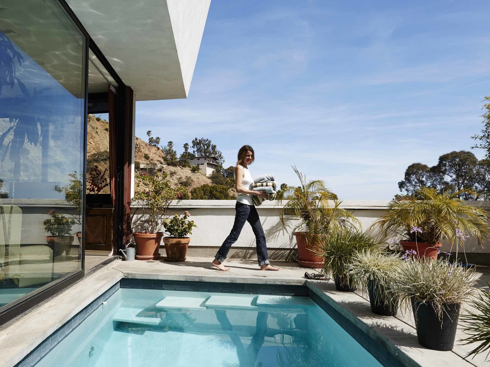 "Their property features an abundance of local flora and fauna. ""We have deer that come from Griffith Park through our garden,"" Judith says.  Modern Pool Design by Dwell"