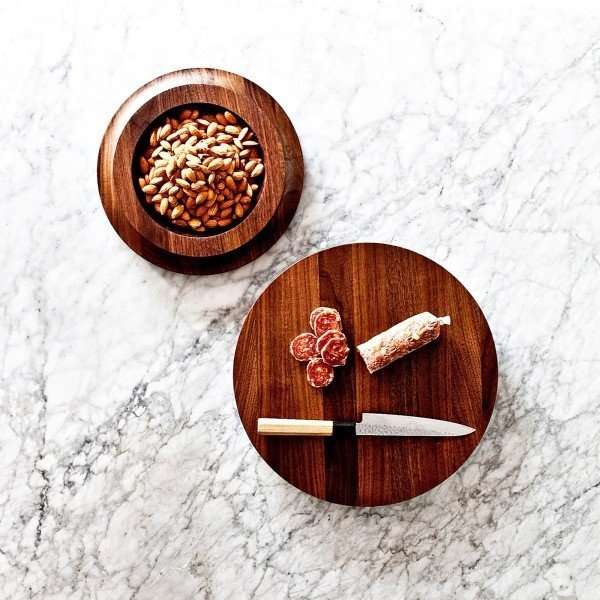 From On Our Table, the BlockBowl is an innovative walnut accessory that is both a cutting block and serving bowl.