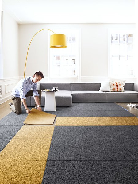 """""""Unlike traditional broadloom and area rugs, we're a modular system that allows you to create custom rugs, runners, and wall-to-wall designs to fit any size and shape,"""" senior designer Cristina Englund says. """"With broadloom rugs, you have to replace whole sections of a rug at a time, but with FLOR you can pick up one square and clean it in the sink."""""""