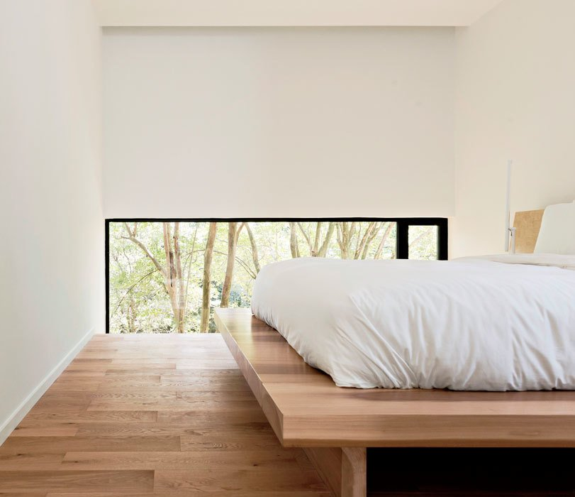 The low windows in the master bedroom focus the view on the backyard, not the neighbors. Christopher designed the solid poplar platform bed. Bedrooms by Dwell
