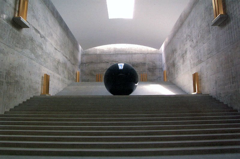 Walter De Maria's 2004 Time/Timeless/No Time sits within a grand subterranean hall, its gleaming surface reflective the sunlight from above. When the sun sets, the space becomes far darker and the sculptures more mysterious.   Photo Courtesy 準建築人手札網站 Forgemind ArchiMedia via flikr.  Photo 17 of 17 in A Texas Couple Builds Their Cast-In-Place Concrete Dream Home
