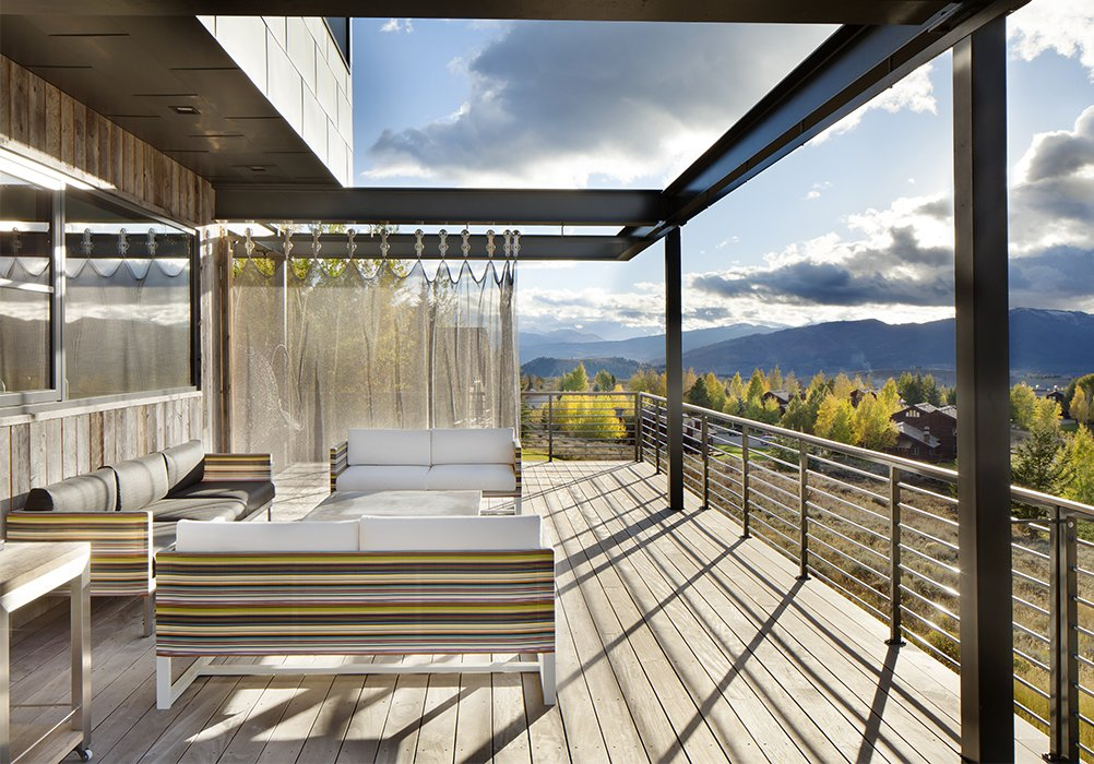 The Conine family engineered the stainless-steel chain-mail mesh curtain system themselves using bedsheets to mock up the design. In the final version, a sunscreen with grommets from Whiting & Davis blocks the blazing sun while standing up to the strong winds of the Jackson Hole valley.