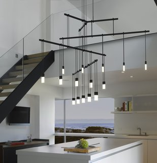 """The Lighting Designer Who Has Melded Form with Function for Decades - Photo 8 of 10 - One of the ways Suspenders can be arranged is in a Tri-Bar configuration. Hanging from a ceiling-mounted outlet box transformer is a 24"""" tri-bar that supports three 36"""" linear power bars, each with five LED luminaires."""