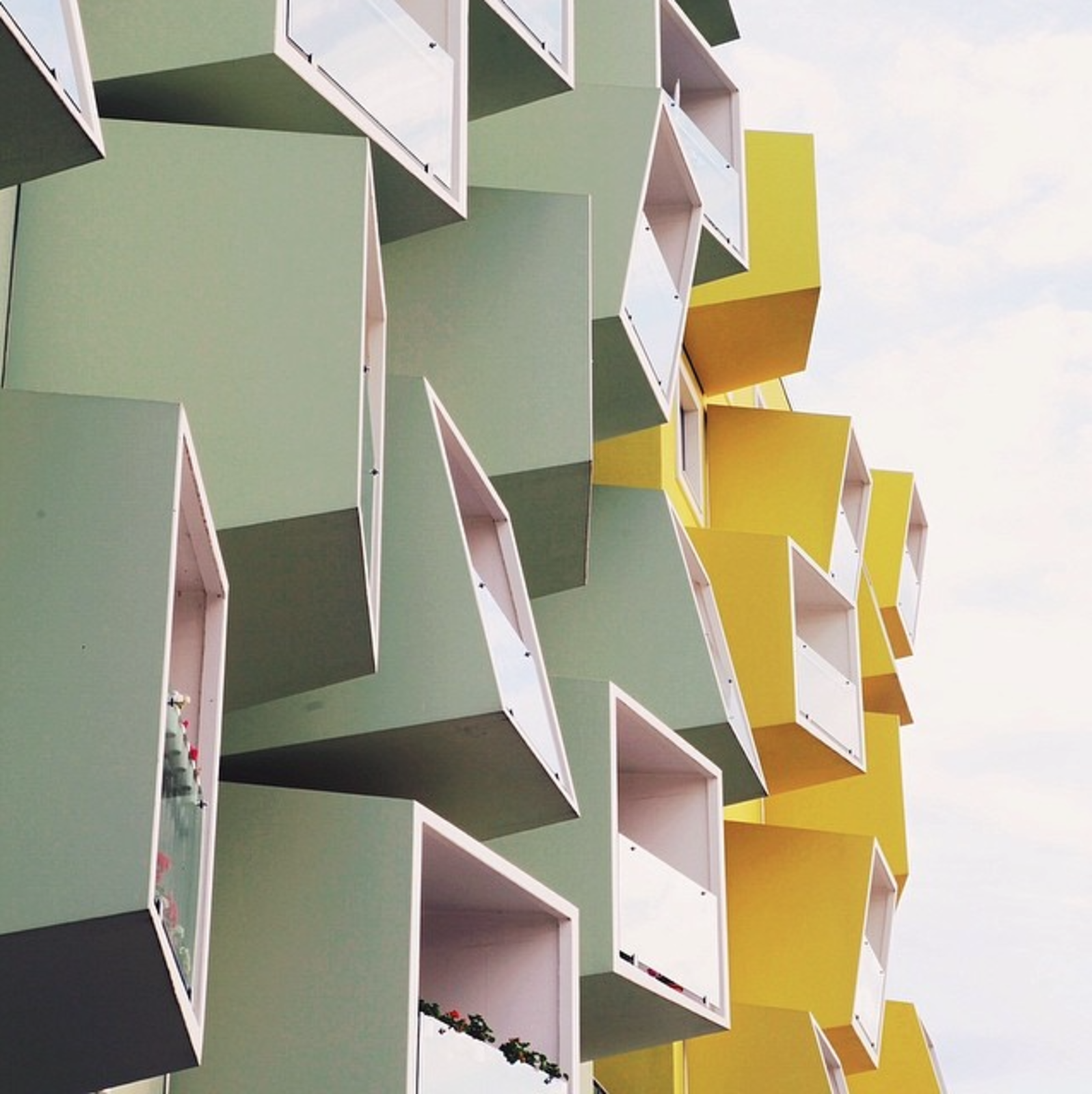 Apartment balconies in Copenhagen, Denmark.  Modern Danish Homes We Love by Aileen Kwun from Instagram Account We Love: Colorful Architecture Snapshots of Cities