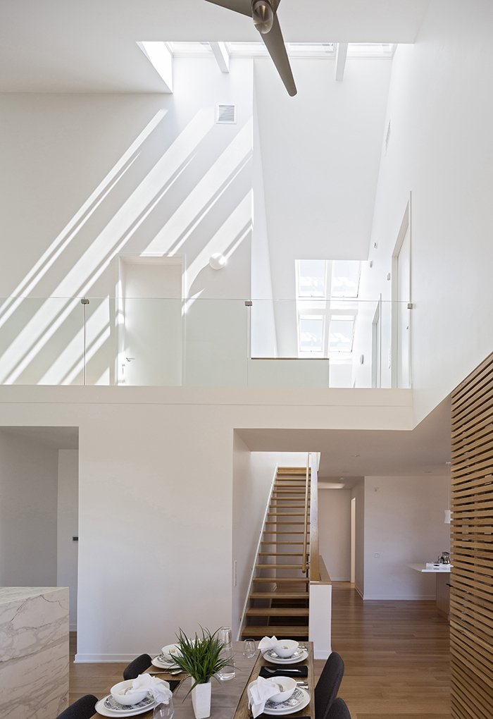 Motorized skylights by Velux, 14 in all, welcome natural light into the house. This Super Smart, Super Green Prefab May Be the Future of Suburban Living - Photo 2 of 4