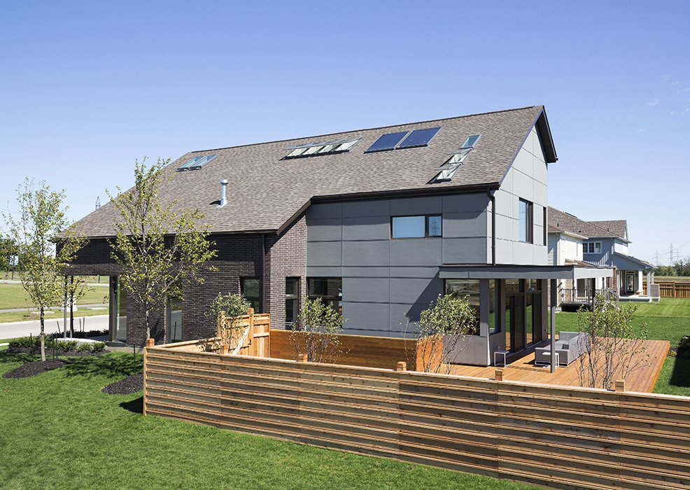 An underground cistern collects rainwater to irrigate the yard and rooftop solar collectors heat water for domestic use. The panelized wood structure was prefabricated to reduce construction time and material waste.  Photo 4 of 4 in This Super Smart, Super Green Prefab May Be the Future of Suburban Living