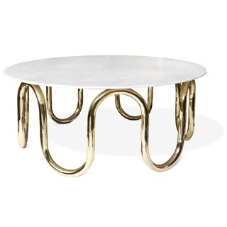 Adler's Scalintatella Cocktail Table was named for his favorite hotel in Capri. Carrera marble atop a hand polished brass base form a simple yet glamorous spot for drinks or magazines.