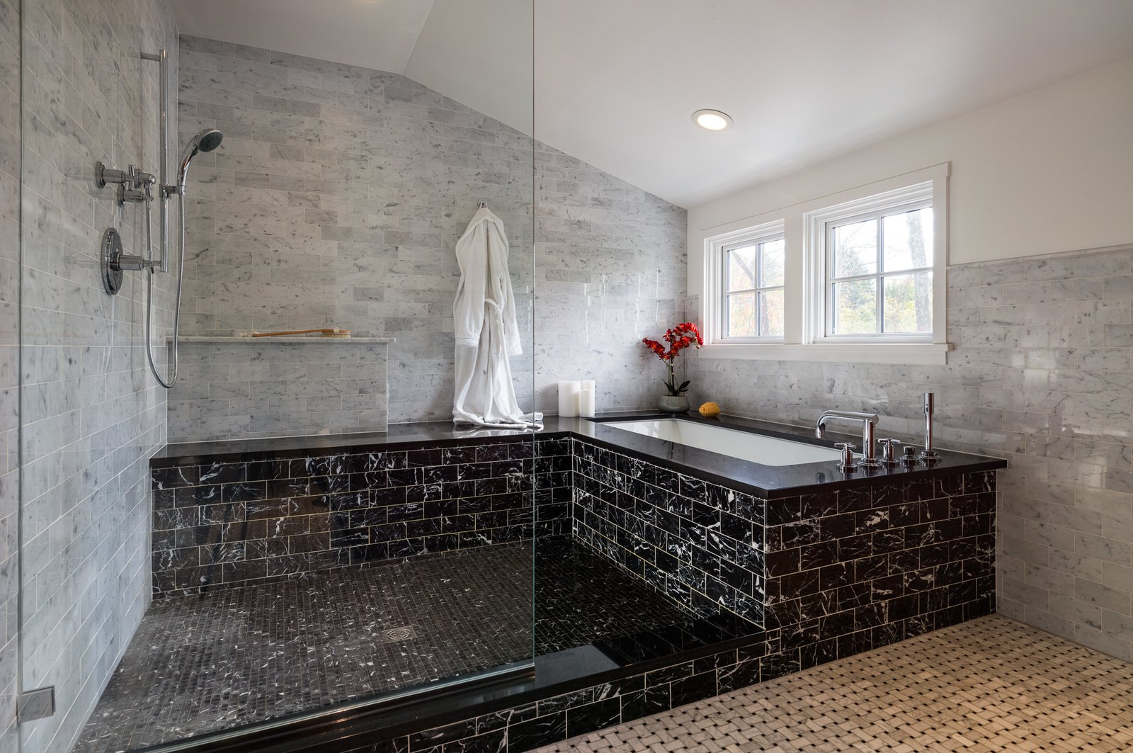 "Marble was used throughout the master bathroom in order to create a timeless feel that would age well. ""The hope is that in 15 years, you won't look at the room and think, 'oh, that tile was only popular in 2015,"" Michael says.  Photo 6 of 8 in A Loving Renovation Updates a Rustic Family Home with Reclaimed Materials"