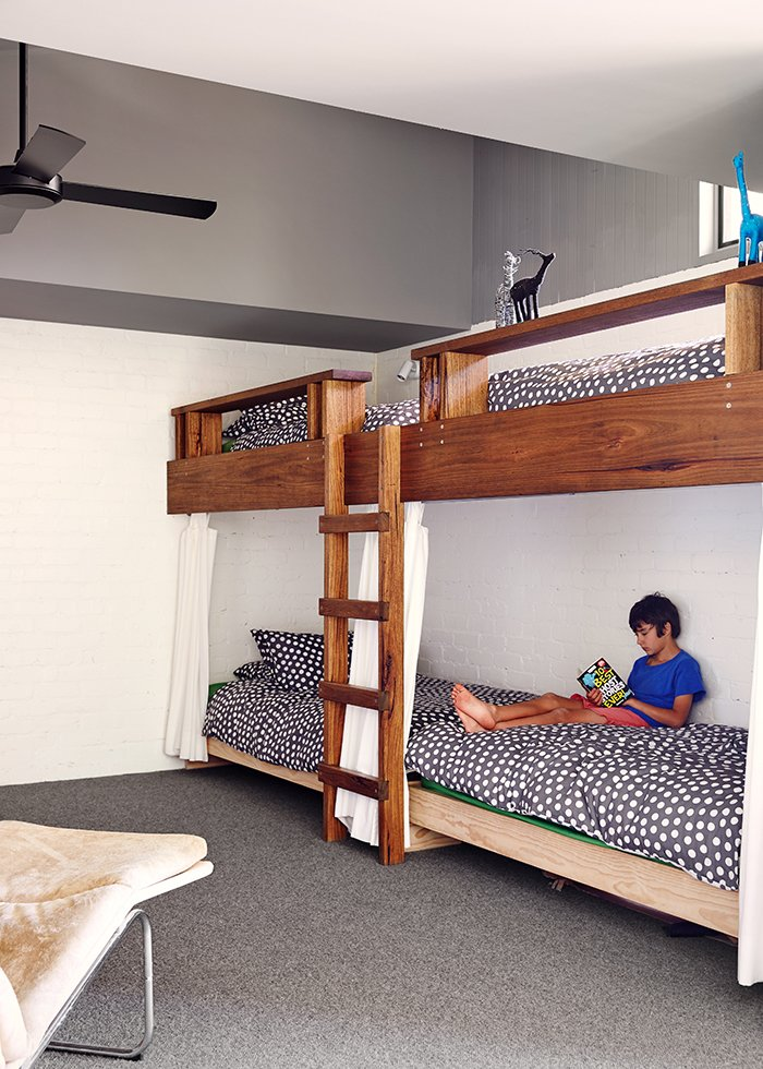 Made from Tasmanian oak, the bunk beds, covered in Kivet duvets by Marimekko, can accommodate four. Tagged: Kids Room, Bedroom, and Bunks.  Photo 5 of 11 in Simplicity Rules at this Family Beach House Designed to Double as a Rental