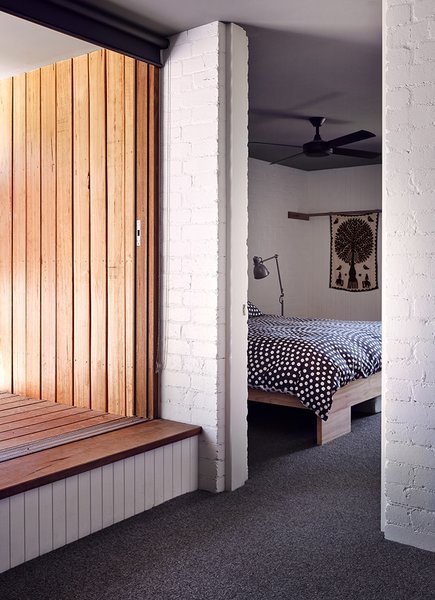 A Hunter Pacific fan cools the master bedroom, which has a custom hardwood bed.