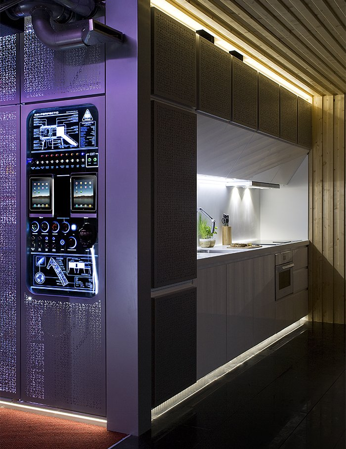 "NOEM integrated the mechanical systems behind a purple screen for users to access. This ""hub"" is the first thing visible upon opening the front door.  Photo 5 of 9 in This Futuristic Prefab in Spain Has All the High-Tech Gizmos of a Spaceship"
