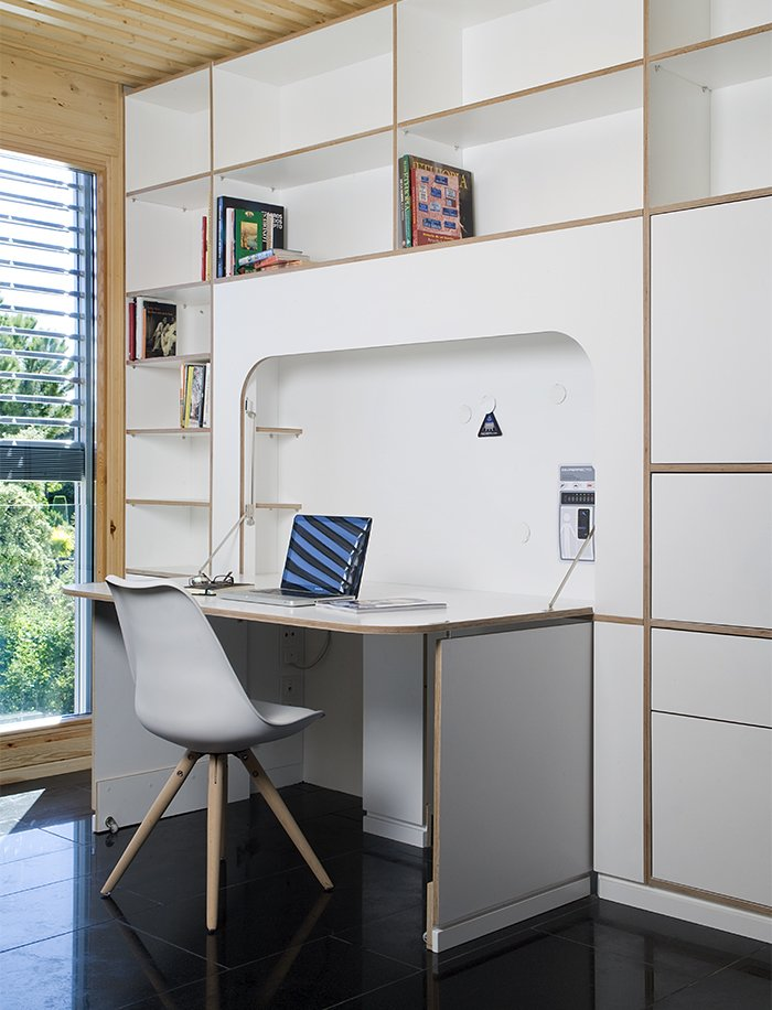 A built-in desk by NOEM FabLab folds into the wall when not in use. Tagged: Office, Bookcase, Chair, Desk, Study, Library, and Shelves.  Photo 8 of 9 in This Futuristic Prefab in Spain Has All the High-Tech Gizmos of a Spaceship