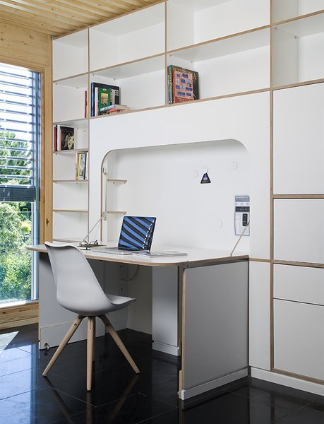 A built-in desk by NOEM FabLab folds into the wall when not in use.