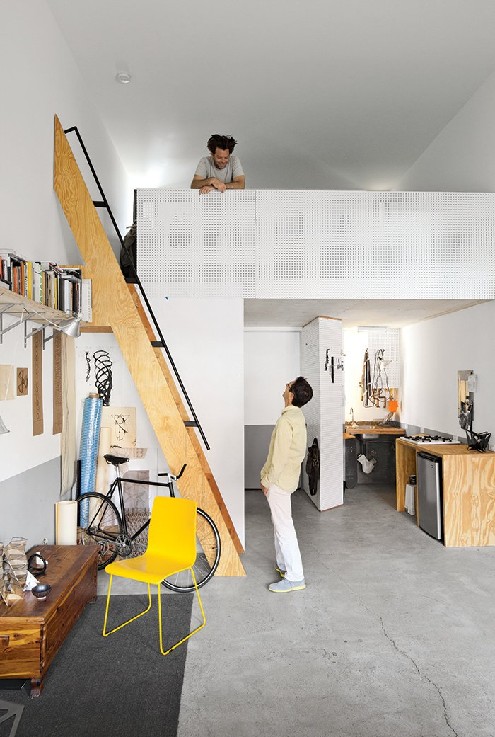 From the mezzanine of his 450-square-foot apartment at La Esquina, an eight-unit live/work building in San Diego's Barrio Logan neighborhood, designer, artist, and Woodbury University professor Patrick Shields chats with fellow professor Hector Perez, who spearheaded the project.