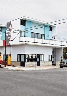 The building's exterior includes a 3-D mural of Cesar Chavez conceptualized by Perez's son, Adrian.