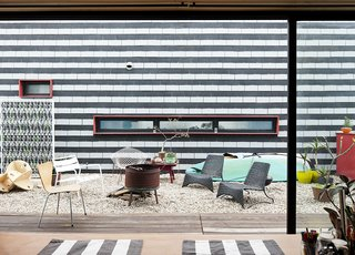 """Creative brainstorming sessions often take place in the building's outdoor spaces. """"Generally we open the porch doors all the way to have any meetings or [do] collaborative work,"""" explains designer Shawn Benson."""