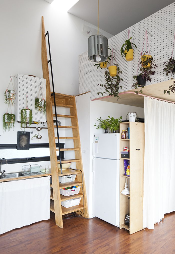 """Food generally plays a part in the exchanges,"" explains Benson, ""so the adjacent kitchen plays its part in lending to that [collaborative] atmosphere.""  Clever Loft Spaces for Small Places by Diana Budds from San Diego Teaches Us How Micro-Living Can Thrive"