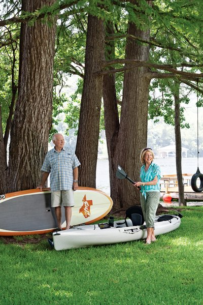 Owners Dudley and Sandy Youman keep a flotilla of watercraft ready for entertaining their children and grandchildren. Interior designer Herb Schoening worked with the Youmans on the furnishings and finishes for their 480-square-foot cabin. Photo by: Kimberly Davis