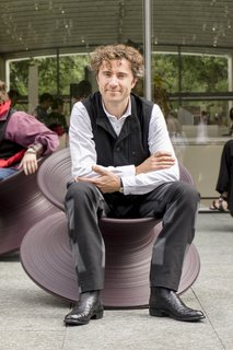 Q&A With British Designer Thomas Heatherwick - Photo 1 of 10 - Thomas Heatherwick seated in the Spun chair he designed in 2010. Made from rotational moulded polyethylene, it's designed by a single profile rotated 360 degrees around an axis.