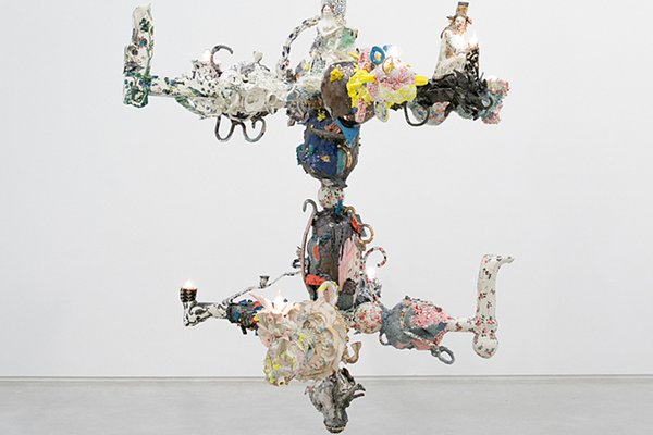 A detail of Francesca DiMattio's Chandelabra II reveals the many ceramic figurines that make up this collage-like porcelain chandelier.