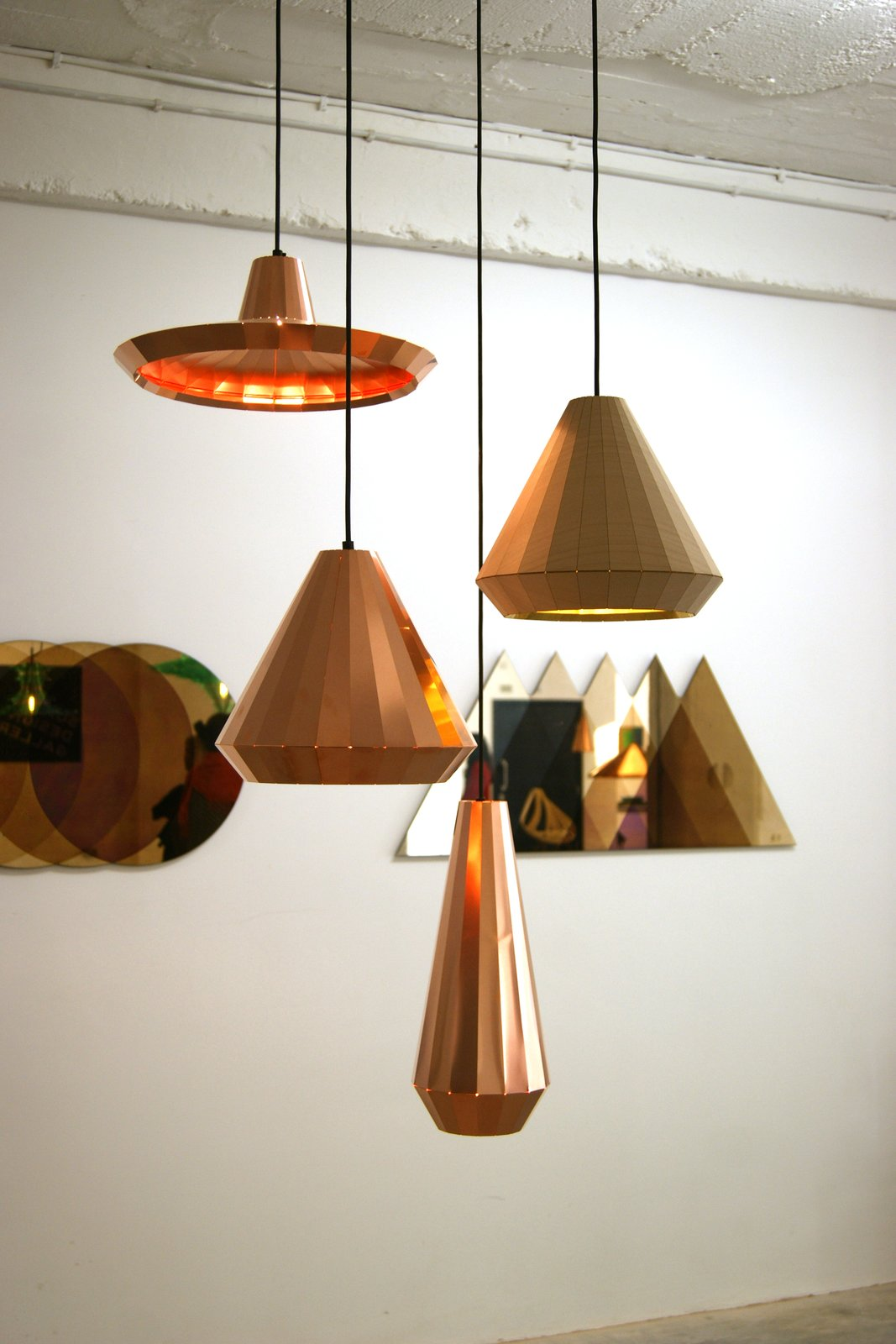 At the TENT London exhibition in east London, Dutch Designer David Derksen exhibited a collection of multi-faceted Copper Lights made from etched and folded copper sheets.  60+ Modern Lighting Solutions by Dwell from Key Trends from 2013 London Design Festival