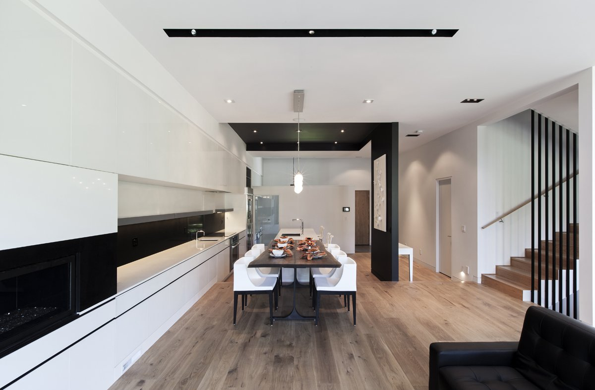 The recessed black ceiling introduces a contrast between the kitchen area and other parts of the house. Tagged: Kitchen, White Cabinet, and Medium Hardwood Floor. Toronto's Tetris Inspired Home - Photo 3 of 7