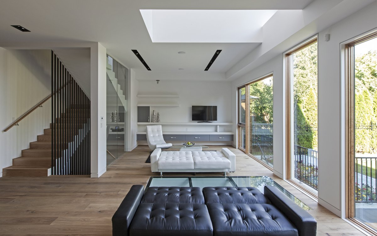 The living area bathed with natural light both from the ceiling to floor glass walls and the void from the second floor allowing one to enjoy tremendous amount of daylight. Tagged: Living Room, Bench, and Medium Hardwood Floor.  Photo 4 of 7 in Toronto's Tetris Inspired Home