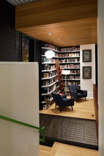 Due to zoning restrictions, the house's footprint had to be relatively small, so Svensen devised a solution: split levels. The library occupies a landing on the staircase and features shelves built by Atlanta's Dark Horse Woodwork.