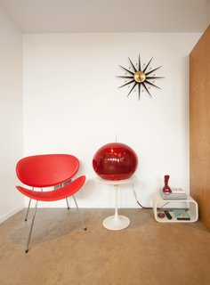 A Tiny Backyard Studio in Seattle Filled With Midcentury Finds - Photo 7 of 8 - The floor is polished concrete, chosen for its durability, low-cost, and minimal maintenance. The red fiberglass armchair is from Modernica.