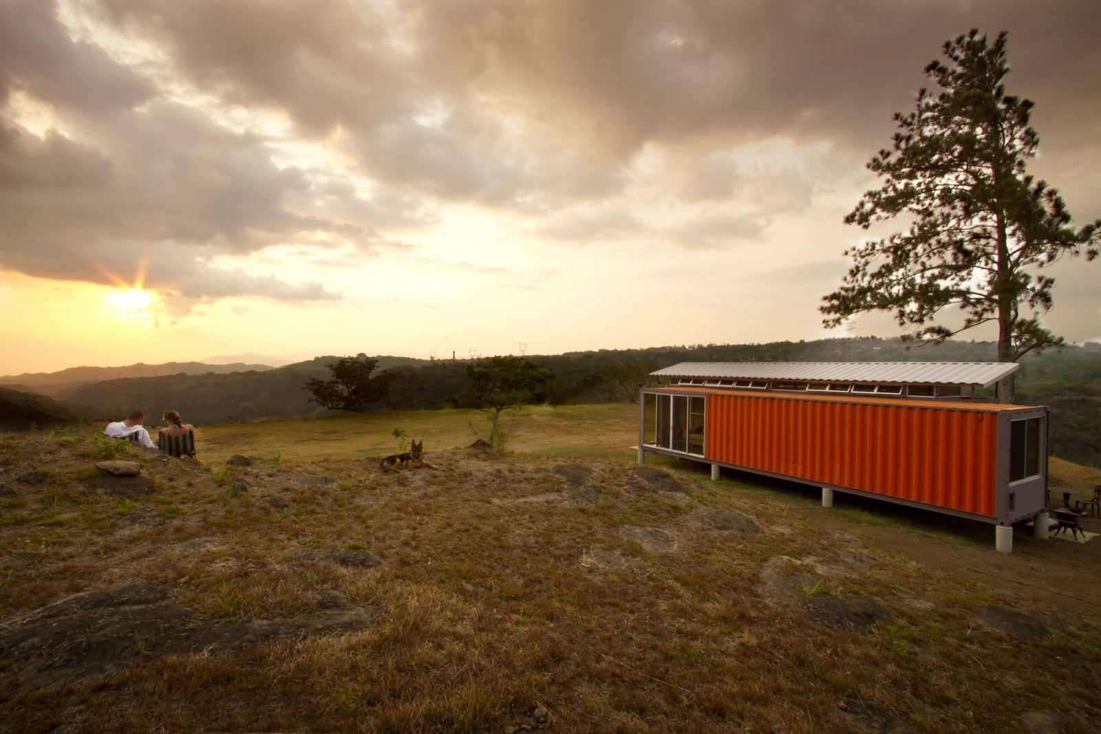 "The recycled shipping containers were sourced from the Pacific Port of Caldera in Costa Rica. ""Discarded shipping containers are all over the world and cost relatively little,"" Saxe says. ""With a bit of creativity and understanding of local building techniques, the interiors can be modified for any client."" Tagged: Exterior, House, and Shipping Container Building Type.  A Budget-Friendly Shipping Container Home in Costa Rica  by Tiffany Jow from How to Buy a Shipping Container"