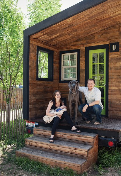 Boise, Idaho–based architectural designer Macy Miller built her own 196-square-foot home, which she shares with her partner, James Herndon, their newborn, Hazel, and the family's Great Dane, Denver. The exterior cladding, which Miller stained for a uniform effect, is a mix of nearly a dozen types of wood plank, including poplar, oak, and fir.