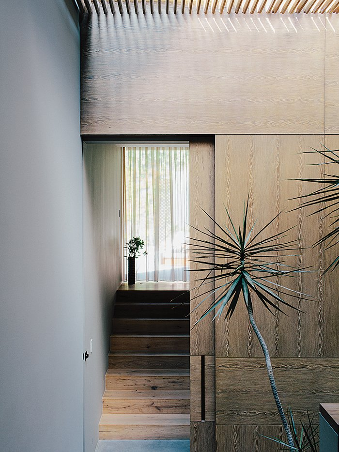 Oak veneer lines the stairwell in between the master bedroom and the children's wing. Tagged: Staircase and Wood Tread.  Photo 5 of 15 in A Lush Retreat With a Sheltered Rooftop Pool in Mexico City