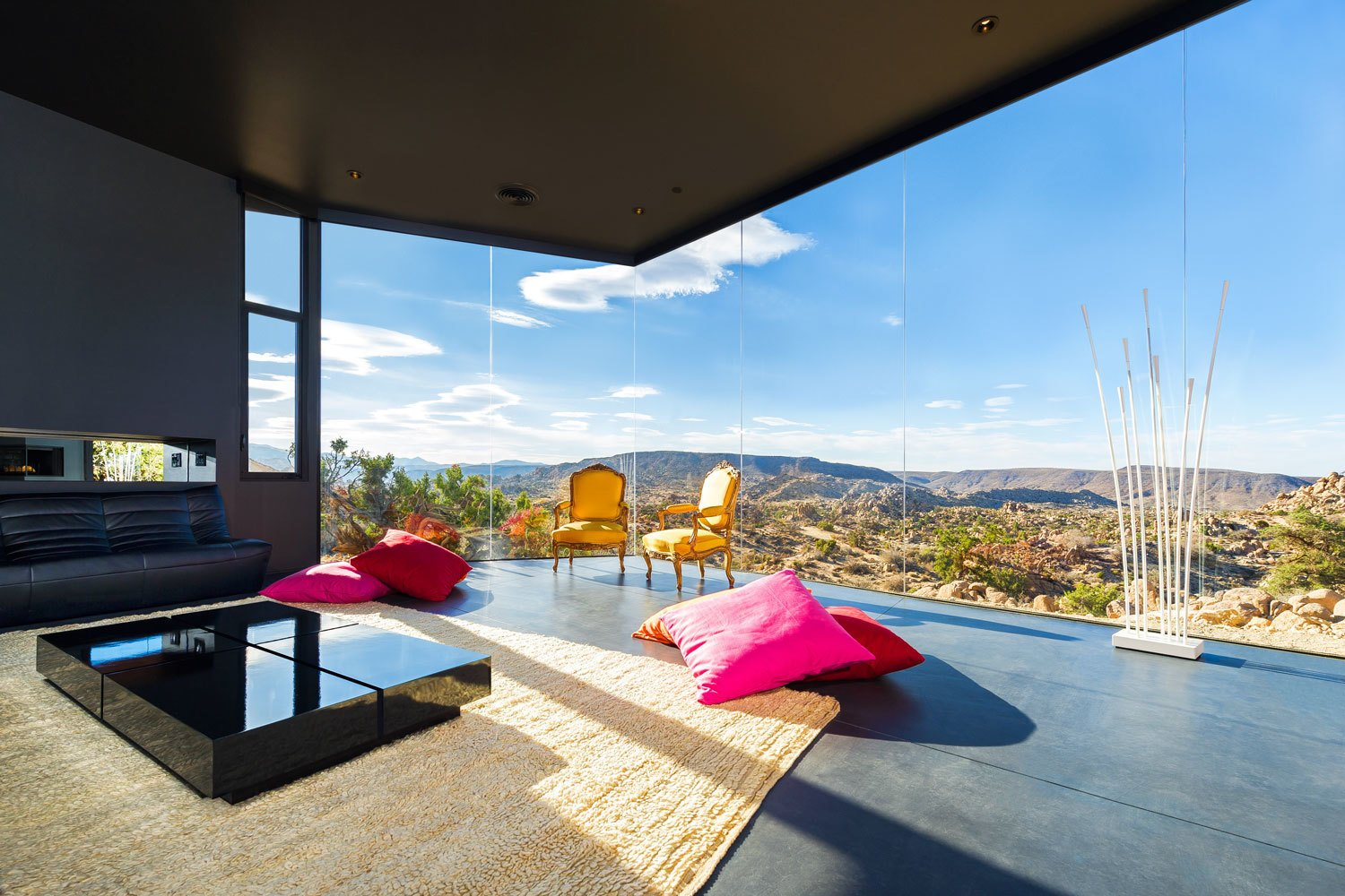 After sundown, the house itself seems to dematerialize into a dark starry expanse. For that reason, the homeowners have likened the living room to a campsite.