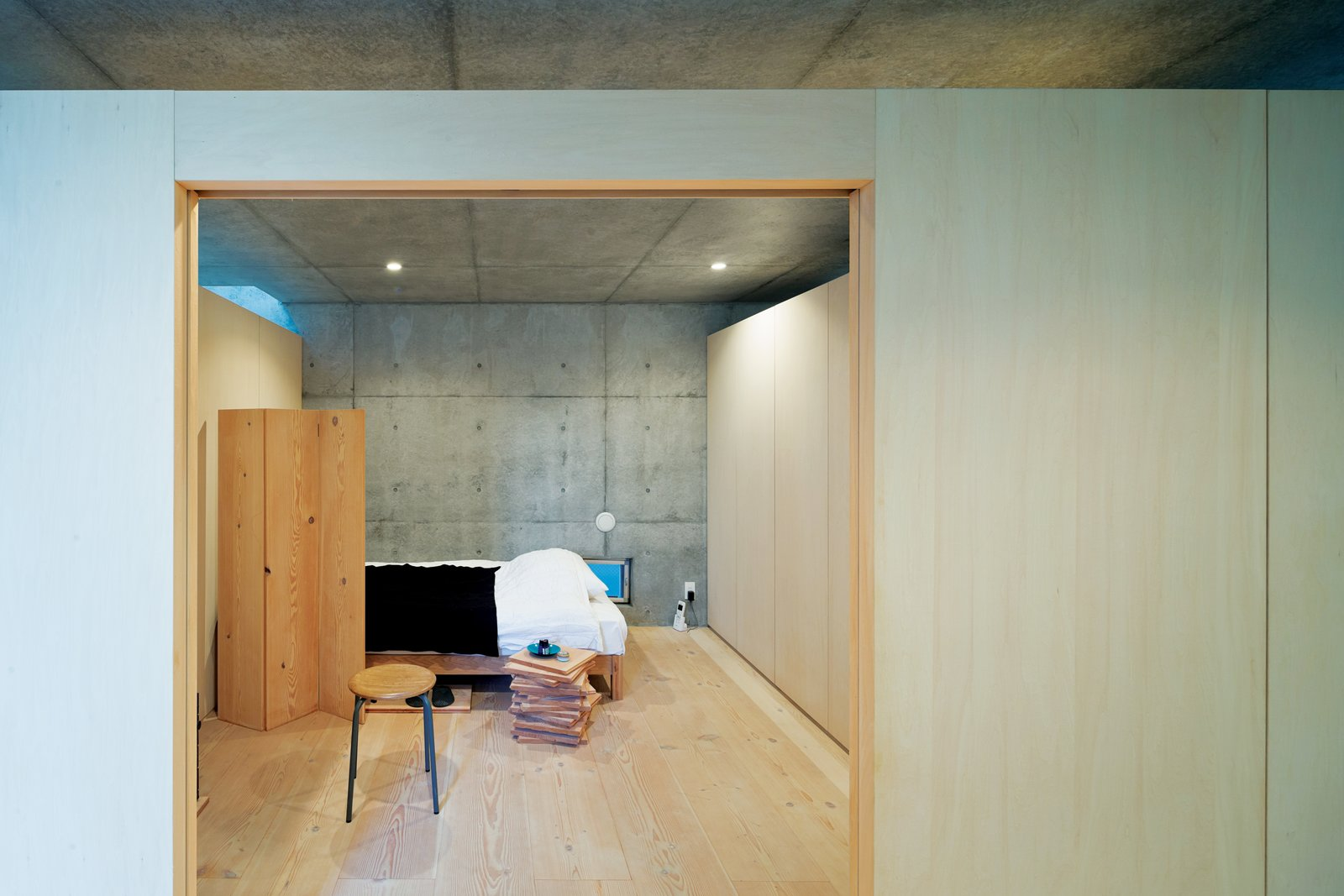 """We adjusted the combinations to see what kinds of spaces they created in relationship to the site and the surrounding buildings,"" his associate Satoshi Ohkami explains. Open-Plan Concrete Home in Japan - Photo 4 of 7"