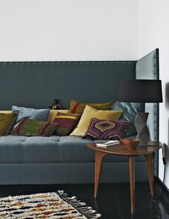 Inside Peter Fehrentz's Renovated Flat in Berlin - Photo 7 of 11 - Fehrentz designed the sofa and had it upholstered in fabric by JAB Anstoetz. He cast the concrete base of the table lamp. The 1950s teak coffee table is vintage.