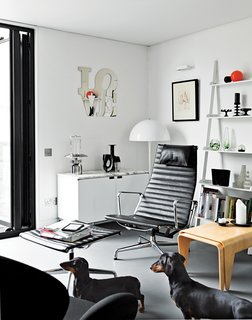 An Elevated Deckhouse in England - Photo 6 of 7 - The room's opposite side holds the companion Breuer nesting tables and an Eames Aluminum Group chair and ottoman.