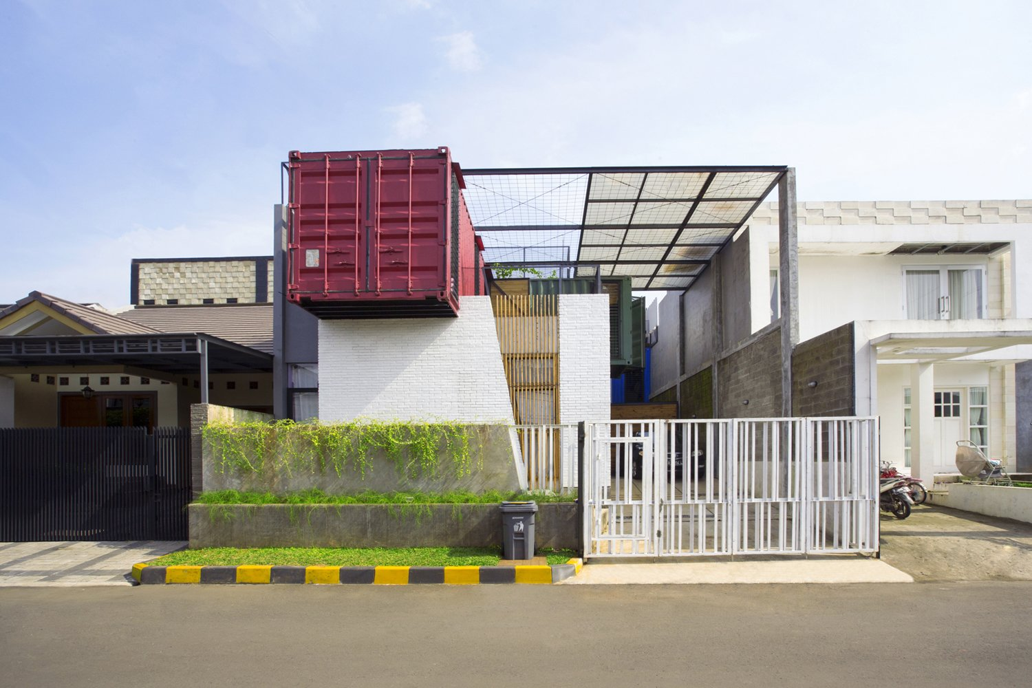 Atelier Riri devised creative ways to make living inside a shipping container in Indonesia's tropical climate both comfortable and economical. The architects layered recycled pine, glass wool, and planter mesh on top of the home to help keep temperatures down. Tagged: Exterior and Shipping Container Building Type.  Shipping Containers by Dwell from How to Buy a Shipping Container