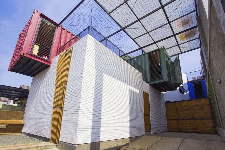 The 1,668-square-foot three-bedroom home is made of four colorful, crisscrossed containers equipped with a simple ventilation system that facilitates a constant breeze. Shipping Containers by Dwell