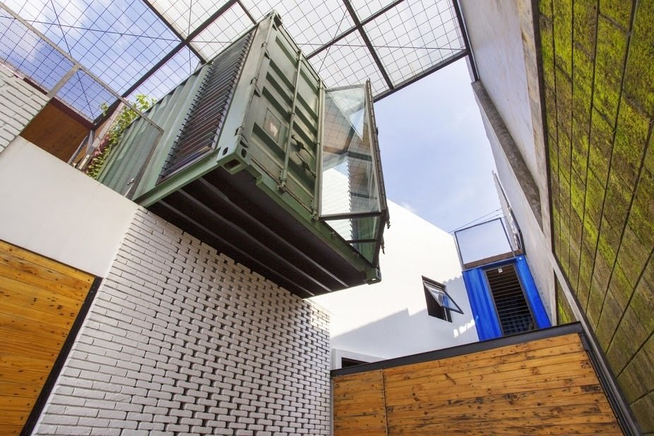 A rich pine exterior complements the brick, which was painted white as a means to minimize the use of cement. Amazing Examples of Shipping Container Architecture by Diana Budds