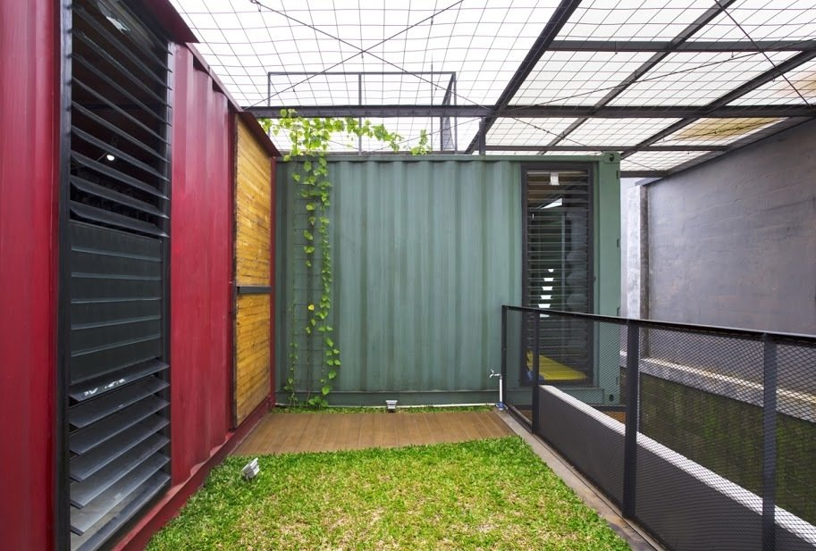 The top of the residence is wrapped in simple wire mesh to encourage plant propagation.  Shipping Containers by Dwell from In Indonesia, a Green-Roofed Container Home Stands Up to the Heat