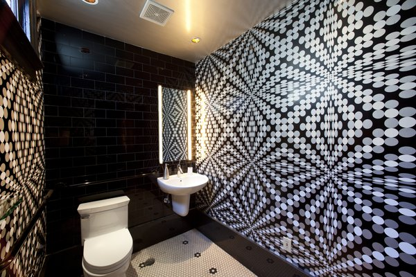 """""""Usage of the space to be wallpapered is also key,"""" Sherman says. """"If you are installing in a bathroom, you certainly don't want to use anything water sensitive. And if you have kids or pets, you don't want anything that can't be cleaned easily. Once you have determined these aspects, you can swing any direction on color and pattern to suit your taste."""""""