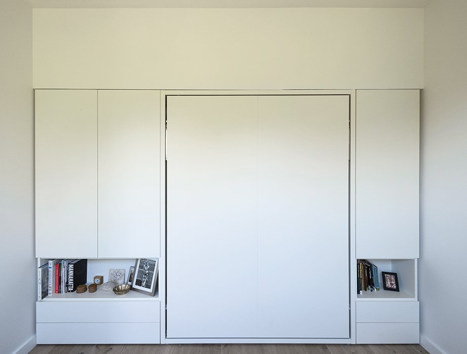 The couple's Murphy bed, Clei's Penelope model, folds up into the wall. Tagged: Bedroom and Bed.  Photo 7 of 14 in How One Family of Three Does It All in 675 Square Feet