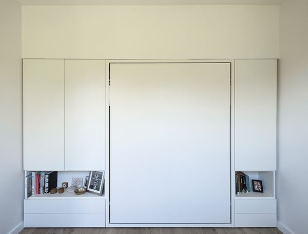 The couple's Murphy bed, Clei's Penelope model, folds up into the wall.