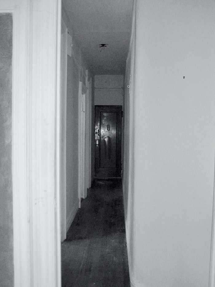 A view of the hallway before renovation.  Photo 10 of 12 in Bright Renovation of a Tiny Manhattan Apartment