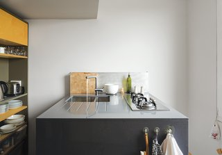 This Is How You Can Live Large in a Small Space - Photo 9 of 9 - The kitchen features a compact cooktop by Whirlpool.