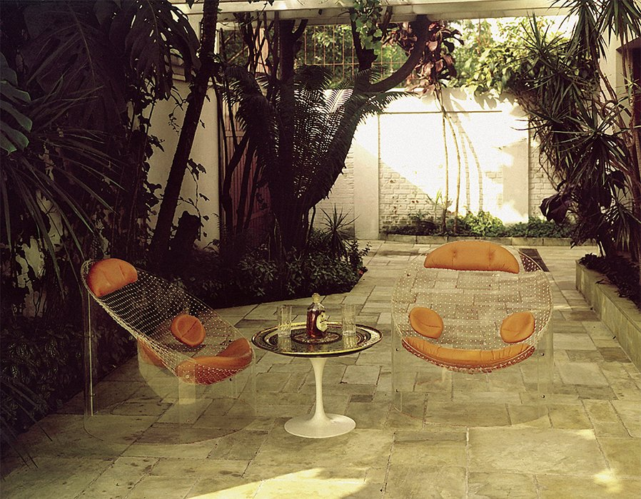 The MP-89 armchair (1970) was made with a diagonally cut Plexiglas cylinder, fishing net, and leather cushions.