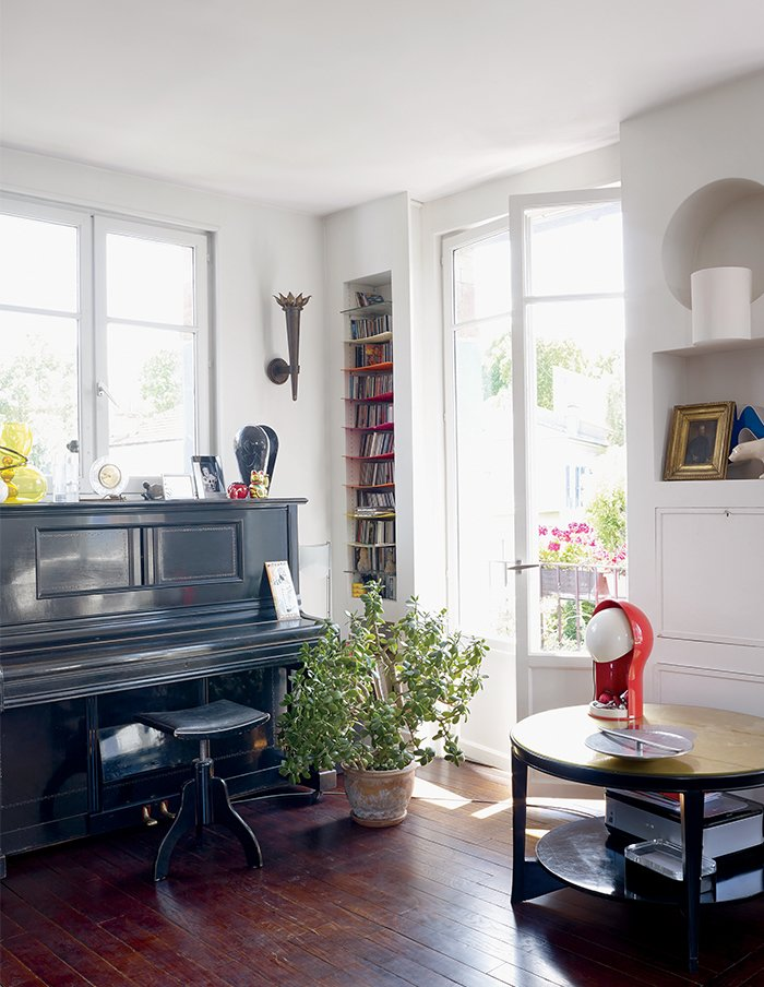 The metal-topped side table is from Roche's grandparents' house and the lamp is vintage Vico Magistretti for Artemide. 10 Dreamy Parisian Homes - Photo 5 of 11