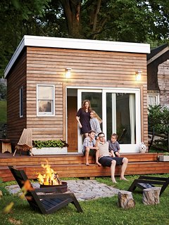 A Family Builds a Tiny Backyard Studio on an Even Tinier Budget - Photo 1 of 8 - When the Ferguson Sauder family—parents Meg, a school counselor, and Tim, a design instructor, plus kids Cole, Olive, and Asher—wanted a multifunctional backyard addition, they decided to build it themselves. Two Liftoff chairs by Tim Miller, one of Tim's former students, surround an oil-drum fire pit set in granite dug up on the property. On the deck, the Panamericana chair is by Industry of All Nations.