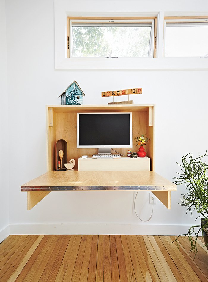 A matching desk also folds up and away. Tagged: Shed & Studio and Storage Space.  Photo 4 of 8 in A Family Builds a Tiny Backyard Studio on an Even Tinier Budget