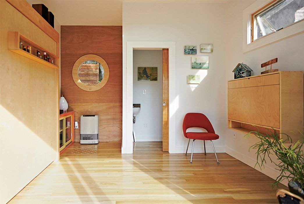 A found Eero Saarinen Executive chair was restored with help from a local auto body shop. Tagged: Living Room, Chair, and Light Hardwood Floor.  Photo 5 of 8 in A Family Builds a Tiny Backyard Studio on an Even Tinier Budget